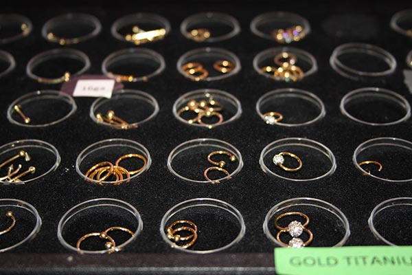 gold-titanium-rings-body-piercing-miss-demeanour-600-400